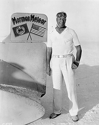 Ab Jenkins next to tail of his record seting Mormon Meteor car, 1931
