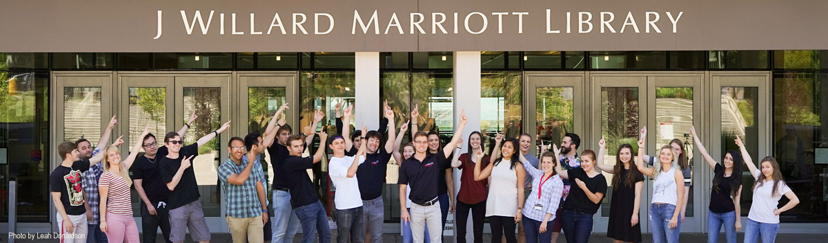 students pointing to the marriott library