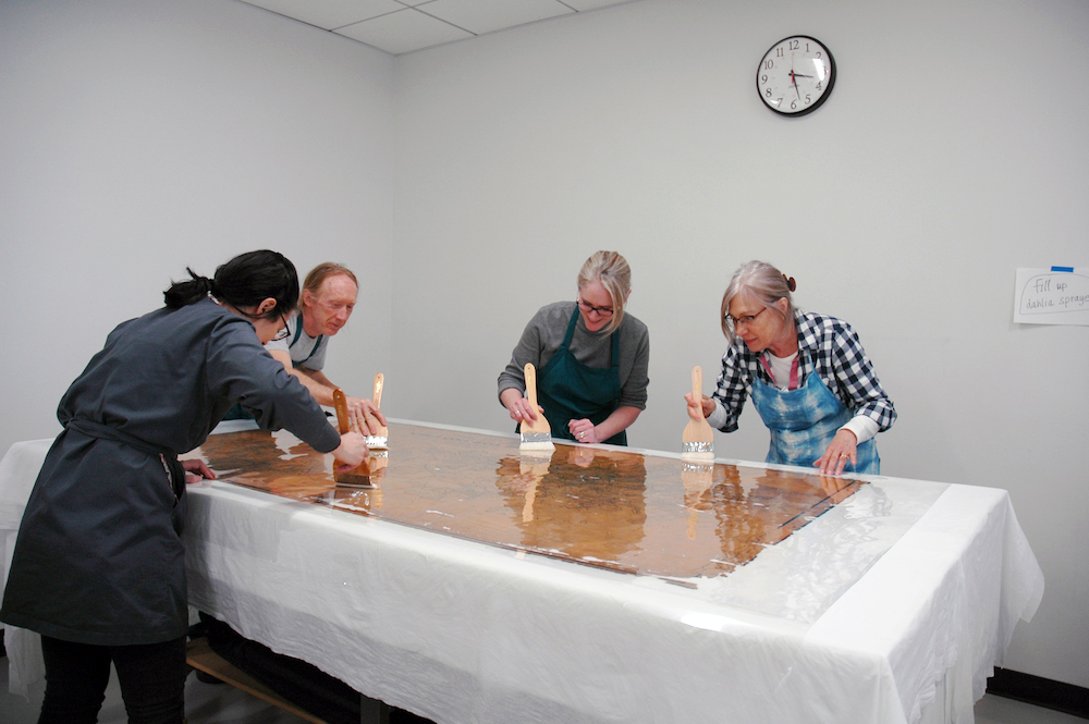 preservation staff treating a map