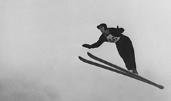 Jumping skiier featured in the Ski Archive Exhibit